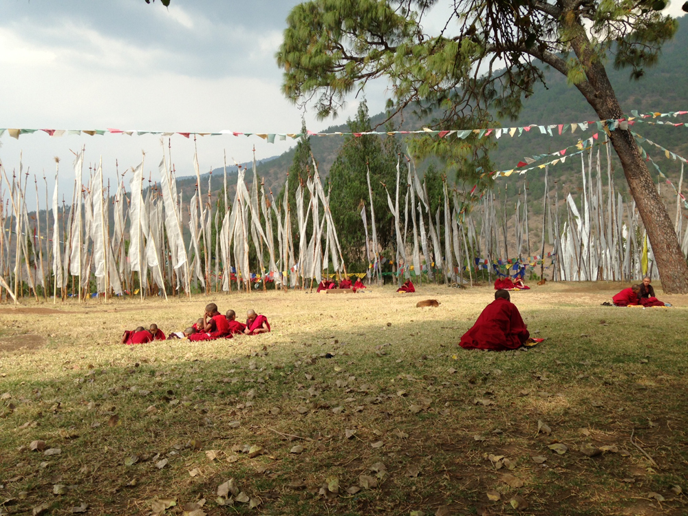 Child monks with prayer flags at a monastery