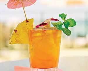 Mai tai drink with fruit garnish, close-up